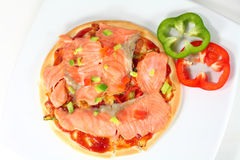 Smoked salmon pizza. Home made smoked salmon pizza Royalty Free Stock Photo