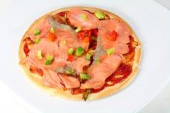 Smoked salmon pizza. Home made smoked salmon pizza Royalty Free Stock Photography