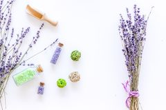 Home spa with lavender herbs cosmetic salt for bath on white desk background top view Royalty Free Stock Photography