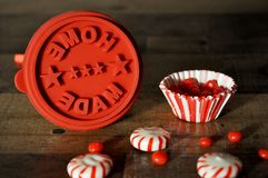 Home made stamp for with peppermint candies and red hots. Home Made Stamp for home made  Christmas gifts with peppermint candies and red hot candies in a striped Royalty Free Stock Photography