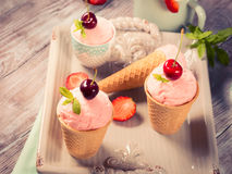 Home made strawberry ice cream served in cones Royalty Free Stock Images