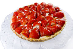 Home made strawberry tart. Home made strawberry tart with confectioner's custard,on a decorated glass plate.Isolated on white Stock Photography