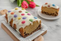 Home made cake with smarties. Home made sweet pound cake with smarties on  a table Stock Image