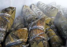 Home made tamales in the fire 2. Pot of fresh steamy home made tamales in a Honduras market stock photo