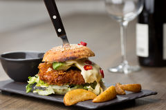 Home made tasty chicken burgers on wooden table Stock Image