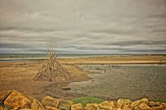 Teepee driftwood  beach Royalty Free Stock Photography