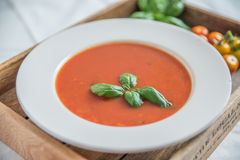 Tomato soup with basil leaves in a bowl Royalty Free Stock Photography