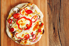 Home made vegeterian margarita pizza on table Royalty Free Stock Photography