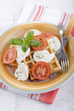 Home made waffle with cheese and tomato Stock Images