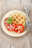 Home made waffle with tomato salad Royalty Free Stock Photo