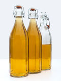 Home made white wine in bottles Stock Photos