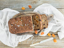 Home-made whole grain bread with dried fruit, seeds and nuts on Royalty Free Stock Images