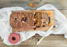 Home-made whole grain Christmas bread with dried fruit, seeds an Stock Photo