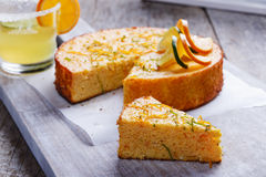 Home made whole testy orange cake on a wooden surface. Home made whole testy orange cake on a wooden Royalty Free Stock Images