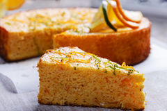 Home made whole testy orange cake on a wooden surface. Home made whole testy orange cake on a wooden Stock Photos