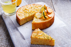 Home made whole testy orange cake on a wooden surface. Home made whole testy orange cake on a wooden Royalty Free Stock Photo