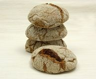 Home made wholemeal vinschgauer buns. On beige underlay Stock Photo