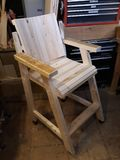 Home made work shop wood chair on wheels royalty free stock photos