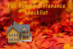 Home maintenance checklist for the fall season. Some fall leaves and yellow and gray house with text fall home maintenance checklist Stock Photo