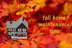 Home maintenance tips for the fall season. Some fall leaves and gray house with text fall home maintenance tips Stock Photos