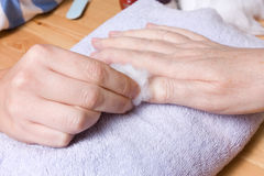 Home Manicure. Older senior woman with arthritic hands receiving home spa treatment / manicure Stock Photos