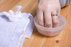 Home Manicure. Older senior woman with arthritic hands receiving home spa treatment / manicure Royalty Free Stock Photography