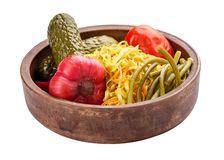 Home marinated vegetables in wooden dishes. stock photography