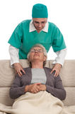 Home massage nurse and old woman Stock Image