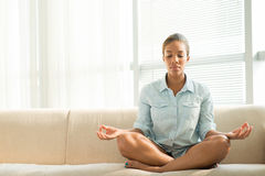 Home meditation. Copy-spaced image of a black woman meditating at home Royalty Free Stock Images