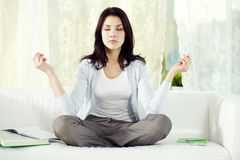 Home meditation. Young girl meditating at home Stock Images