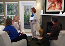 Home Meeting. A woman shows her product catalog at an in home party Royalty Free Stock Photography