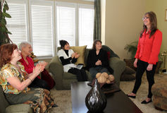 Home Meeting. Diverse women applaud while listening to a presenter at a home business meeting Stock Photography