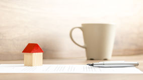 Home Miniature, Pen and Contract on Table Stock Photos