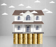 Home model on a coins. Loan concept stock photos
