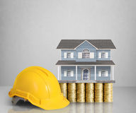 Home model on a coins. Loan concept royalty free stock photos