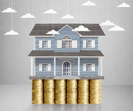 Home model on a coins. Loan concept royalty free stock images