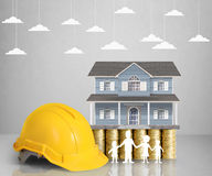 Home model on a coins. Loan concept royalty free stock image