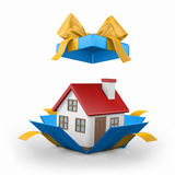Home. Model of a house in gift box with ribbon Royalty Free Stock Photos