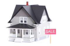 Home model with sale sign, isolated Stock Photos