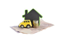Home, money and car ideas for saving on white background Stock Photo