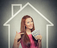 Home, money, people concept. Successful business woman holding dollar cash money Royalty Free Stock Photography