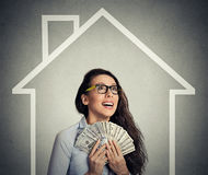Home, money, people concept. Successful business woman holding dollar cash money. Home, money, people concept. Smiling young successful happy business woman Royalty Free Stock Image