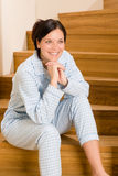 Home morning woman in pajamas on staircase Stock Images