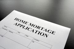 Home mortage application. Form on desktop in office showing real estate concept Stock Photography