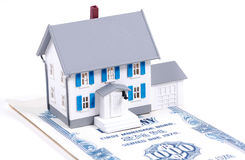 Home Mortgage. Miniature House on a Mortgage Bond Stock Image