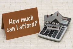 Free Home Mortgage Affordability, A Gray House, Brown Card And Calculator On Stone Background Stock Photos - 63215383