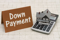 Home Mortgage Down Payment, A gray house, brown card and calcula. Tor on stone background with text  Down Payment Stock Photo
