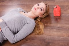 Woman lying with cash box. Royalty Free Stock Photos