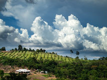 Home on mountain. And white cloudy in the sky Stock Photography