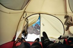 Home on a mountain. A tent set up high on Mount Rainier, the climbers resting before a summit bid Stock Photos